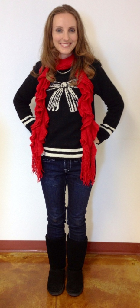 Black bow sweater, denim jeggings.  Accessories:  red scarf and Bearpaw boots