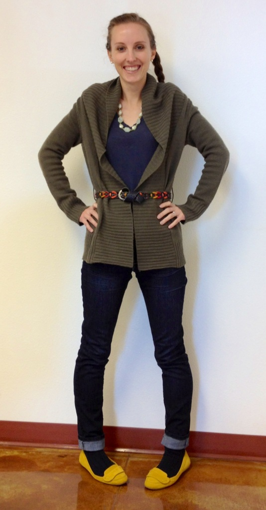 Green sweater, blue long-sleeve shirt, denim jeggingsAccessories:  multi-colored belt, blue knit socks, mustard flats