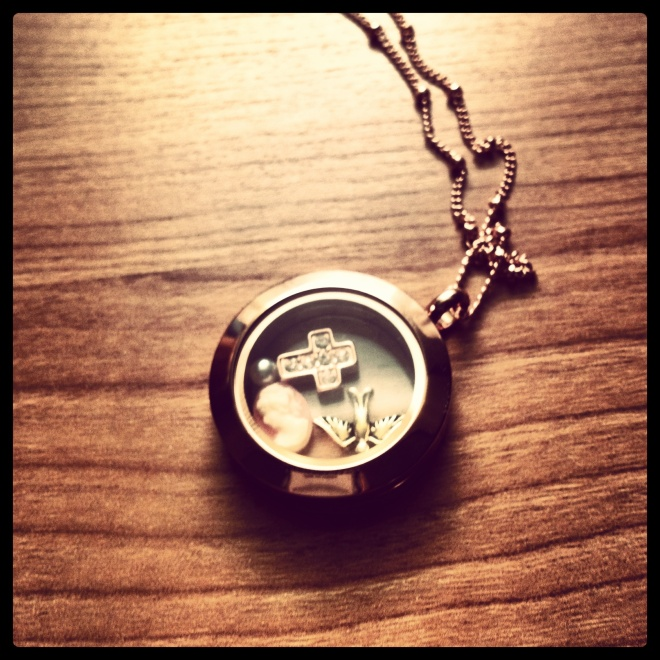 My new Origami Owl locket and necklace in rose gold.  The charms - a sparrow, coral cameo, a pearl, and a cross.